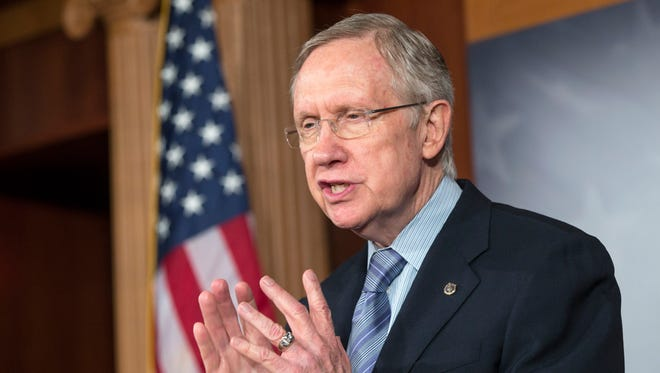 Sen. Harry Reid says attempts to cut funding for the health care law are dead in the Senate.