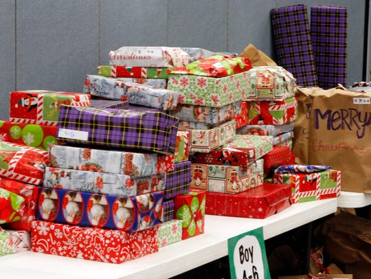 New gifts were wrapped and given to children 12 and