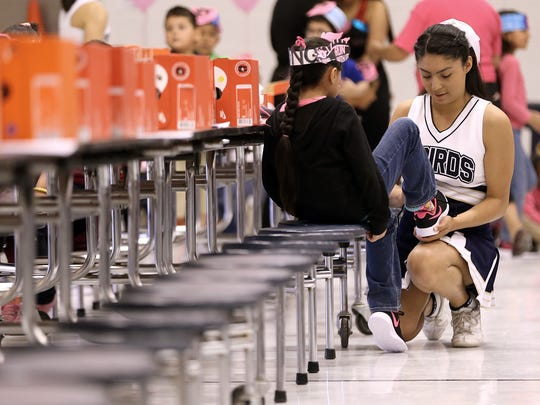 Over 500 pairs of shoes were given to students at Rojas
