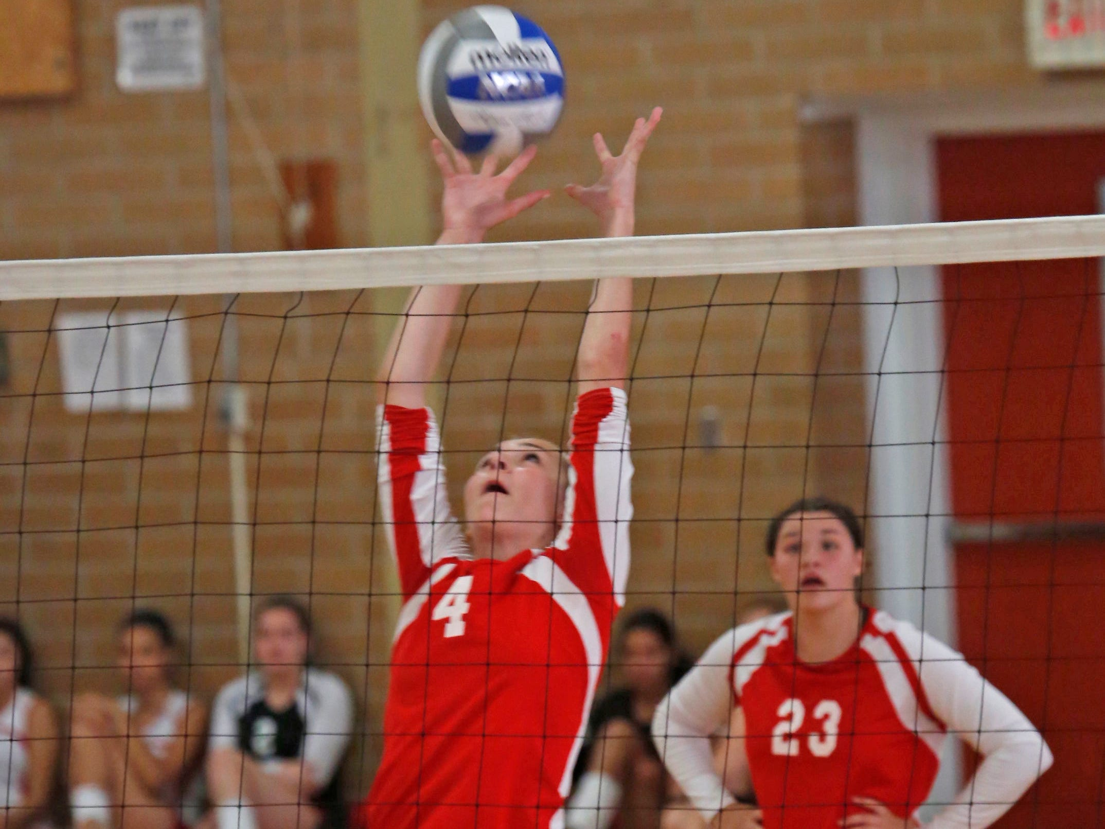 North Rockland's Madison Monahan (4) returns to New Rochelle during the game at North Rockland High School in Thiells on Sept. 2, 2014. New Rochelle won the first two sets.