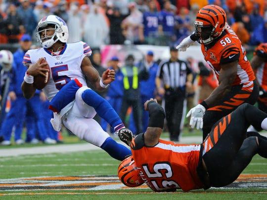 Oct 8, 2017; Cincinnati, OH, USA; Buffalo Bills quarterback Tyrod Taylor (5) is tackled by Cincinnati Bengals outside linebacker Vontaze Burfict (55) in the second half at Paul Brown Stadium.