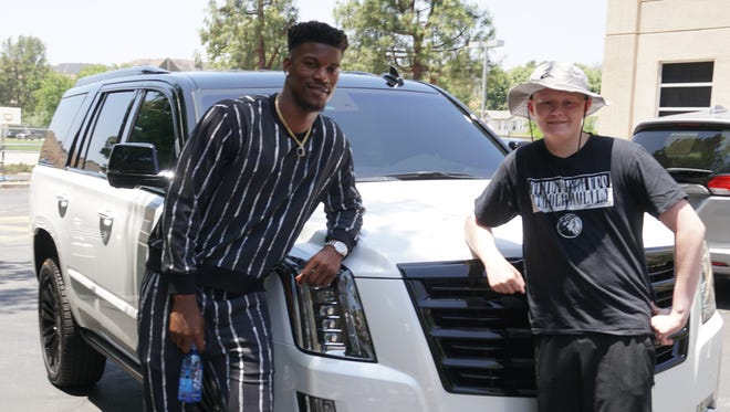 Ethan Whitney, right, hung out with Jimmy Butler for a day in June — including taking his Cadillac Escalade for a spin.