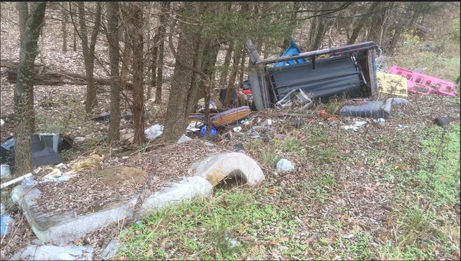 This December photo shows illegal dumping on the side of Rocky Fork Interchange, a rural neighborhood near a Rocky Fork Road overpass of Interstate 24.