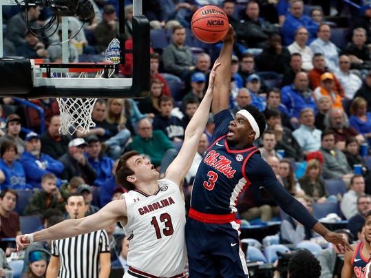 Mississippi 's Terence Davis (3) is unable to score past South Carolina's Felipe Haase during the first half in an NCAA college basketball game at the Southeastern Conference tournament Wednesday, March 7, 2018, in St. Louis. (AP Photo/Jeff Roberson)