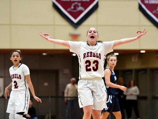 Saddle River Day's Michelle Sidor celebrates a three-pointer