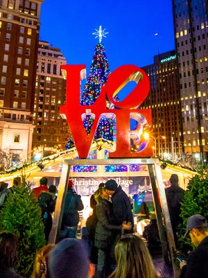 The iconic Love Park statue by Robert Indiana provides the backdrop for many holiday cards set at the Christmas Village.