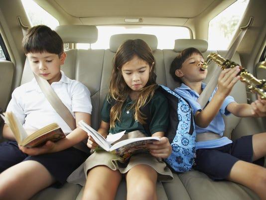 Children reading in car