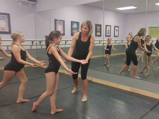 Amy Emmett working with some of her students at the