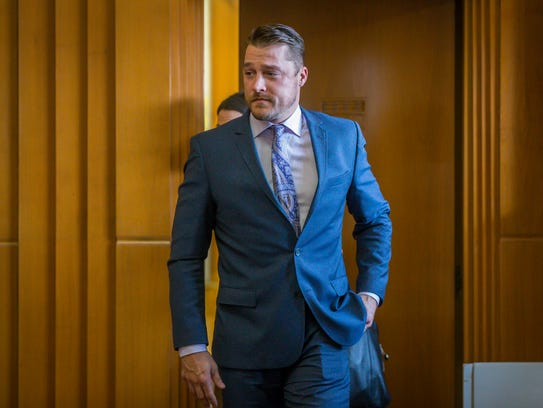 Chris SoulesÊenters the courtroom for a hearing in
