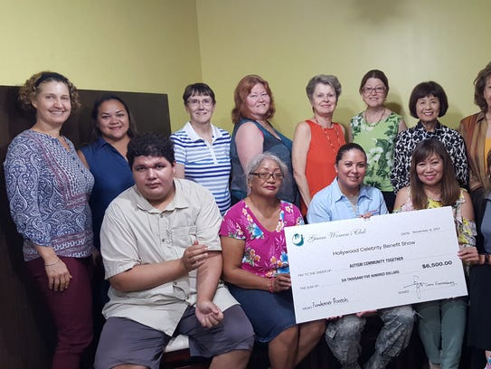 Guam Women's Club presented a check in the amount of