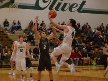 In battle of unbeatens, Olivet soars over Perry