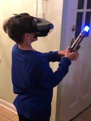 Samuel Baig wields a Lightsaber controller as a Jedi