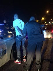 Members of the Jackson Police Department Gun Crime Interdiction Team make an arrest May 8, 2018.