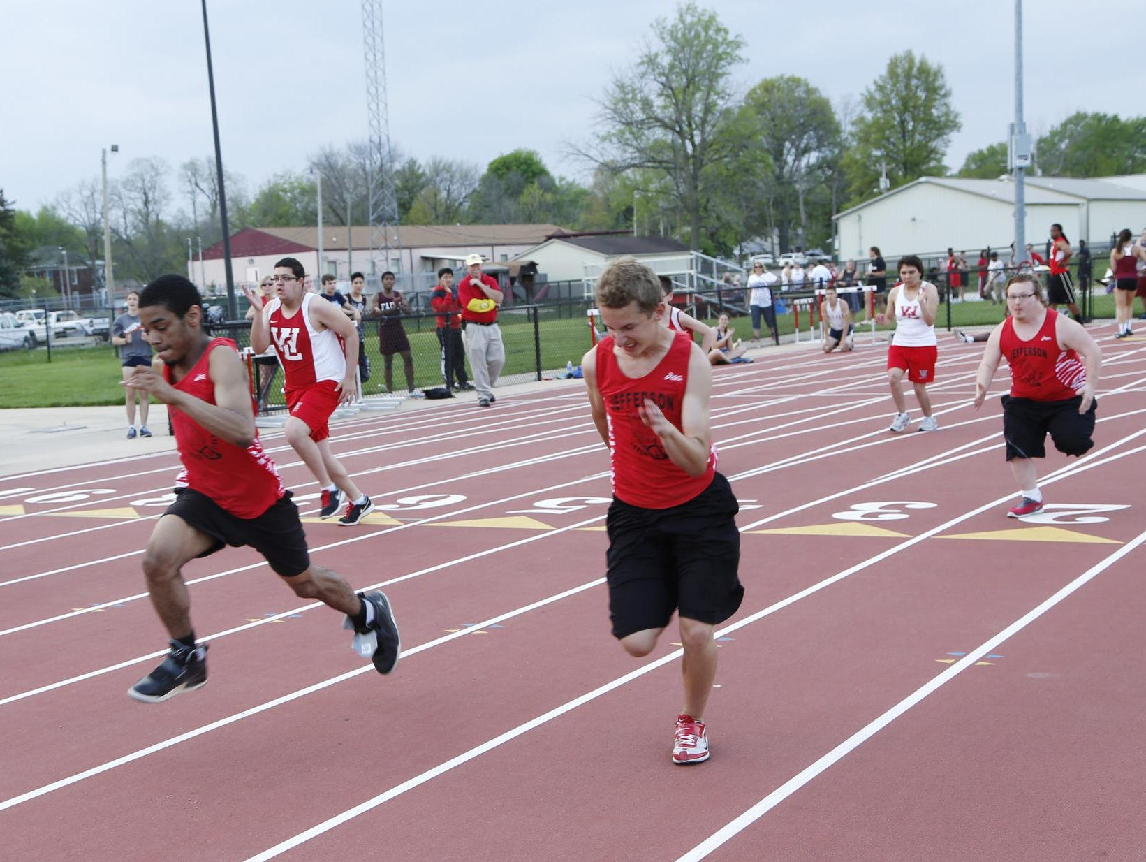 Unified teams from Lafayette Jeff and West Lafayette compete in the first heat of the 100 meter dash during the City County Track Meet Tuesday, May 5, 2015, at Lafayette Jeff High School.