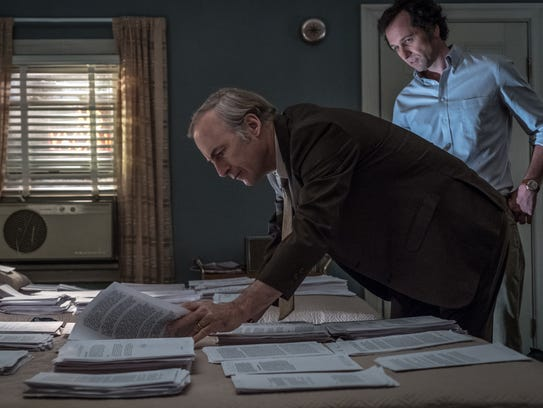 """Among the old-fashioned elements in """"The Post"""" is journalists needing to sort and transport reams of paper instead of electronic files. Here actor Bob Odenkirk, as Ben Bagdikian, sorts through the Pentagon Papers."""