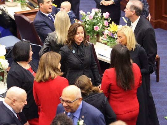 Florida senators meet and greet each other on the floor prior to the first day of legislative session, Tuesday, Jan. 9, 2018, in Tallahassee, Fla.