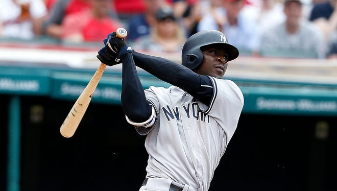 New York Yankees' Didi Gregorius watches his two-run home run off Cleveland Indians starting pitcher Danny Salazar during the third inning of a baseball game Saturday, July 9, 2016, in Cleveland.