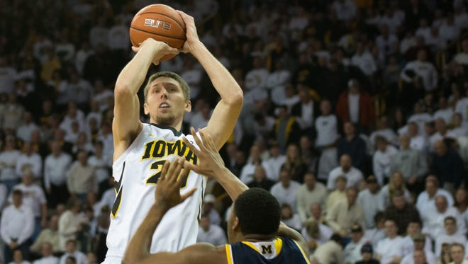 Jarrod Uthoff shoots over Michigan's Zak Irvin during the first half of the Hawkeyes' 82-71 victory over the Wolverines at Carver-Hawkeye Arena Sunday.