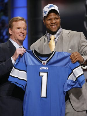 Ndamukong Suh, right, holds up a jersey with NFL commissioner Roger Goodell after he was selected as the second overall pick in the 2010 NFL Draft by the Detroit Lions.