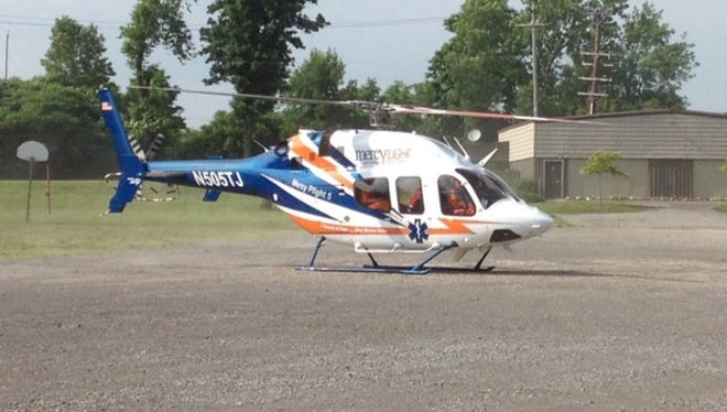 Several passengers in a one-car crash in Ontario County were flown to Strong via Mercy Flight. An 11-year-old girl in the car was pronounced dead at the scene. This is a photo from 2012 of one of Mercy Flight's helicopters.