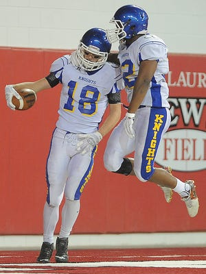 O'Gorman's Jack Peery (18) and Dodi Makwinja (32) celebrate after scoring against Washington during the Class 11AAA Championship game at the DakotaDome in Vermillion on Sat., Nov. 14, 2015. The two players are set to participate in the South Dakota High School All-Star Football Game on July 9.