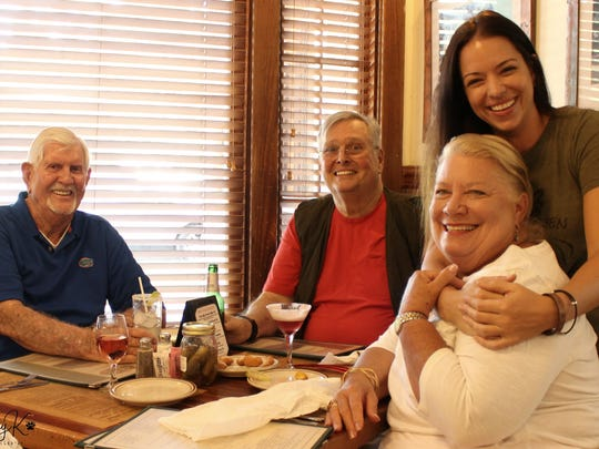 Chuck Black (from left), David Nolte, Jacque Petrone and Michele Nolte enjoying a HALO (Helping Animals Live On) event in Fellsmere in August 2017.
