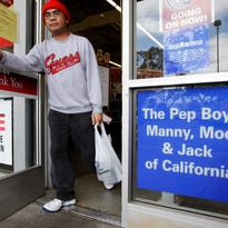 Customer leaves a Pep Boys auto parts store in Hayward, Calif.