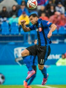 Montreal midfielder Dilly Duka goes up to head a ball