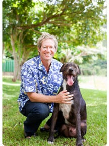 Father Bill Miller, an Episcopal priest and author, poses with his canine companion, Wili.
