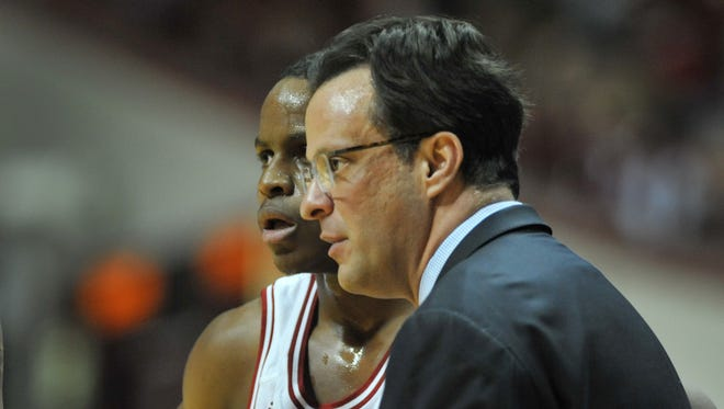 Can Yogi Ferrell (left) and Tom Crean (right) begin Indiana basketball's turnaround in Montreal over the next week?