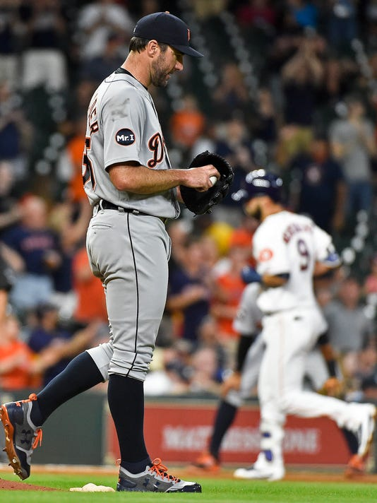 Detroit Tigers starting pitcher Justin Verlander, left, walks off the mound as Houston Astros' Marwin Gonzalez, right, rounds the bases after hitting a two-run home run during the fourth inning of a baseball game, Thursday, May 25, 2017, in Houston. (AP Photo/Eric Christian Smith)