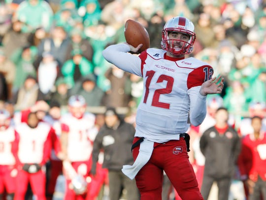 Western Kentucky Hilltoppers quarterback Brandon Doughty (12) passes the ball against the Marshall Thundering Herd in overtime for a two point conversion to win the game at Joan C. Edwards Stadium.