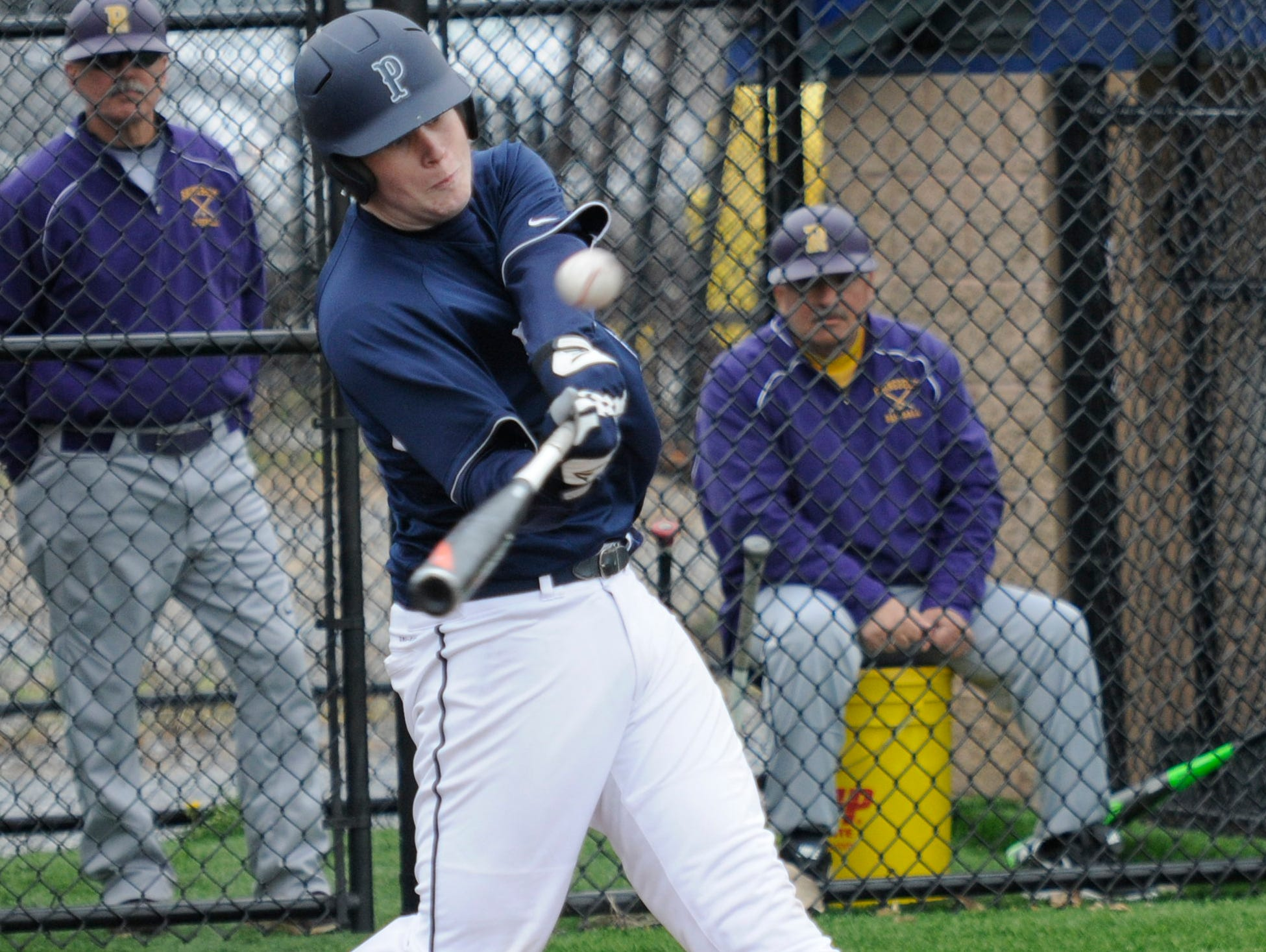 Poughkeepsie's Cullen O'Shea hits a grand slam home run in the sixth inning of Saturday's game versus Rhinebeck at Poughkeepsie High School.