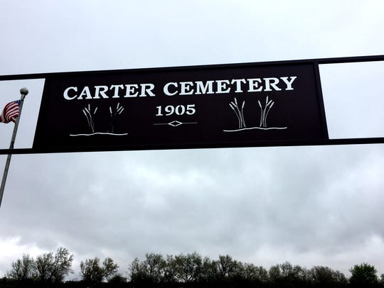 A sign is above the Carter Cemetery entrance, which