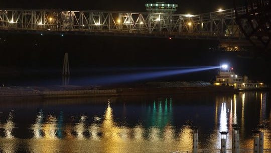 The barge involved in the fatal wreck sits in the middle of the Ohio River Downtown.