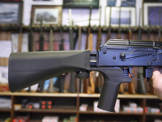 A bump stock device is installed on a AK-47 semi-automatic