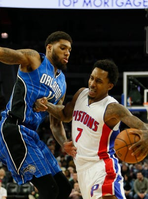 Pistons guard Brandon Jennings forces his way past the Magic forward Devyn Marble in the first half on Wednesday at the Palace.
