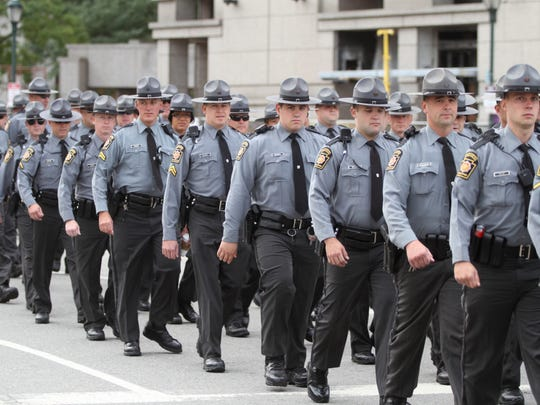 Pennsylvania State Police march through Logan Circle