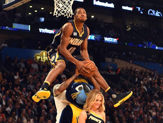Indiana Pacers forward Glenn Robinson III leaps over