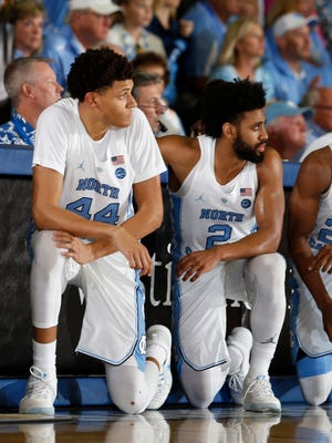 From left to right North Carolina Tar Heels forward Justin Jackson (44), guard Joel Berry II (2), and guard Kenny Williams (24) wait to check into the game against the Wisconsin Badgers in the Championship Game of the Maui Jim Maui Invitational at the Lahaina Civic Center.