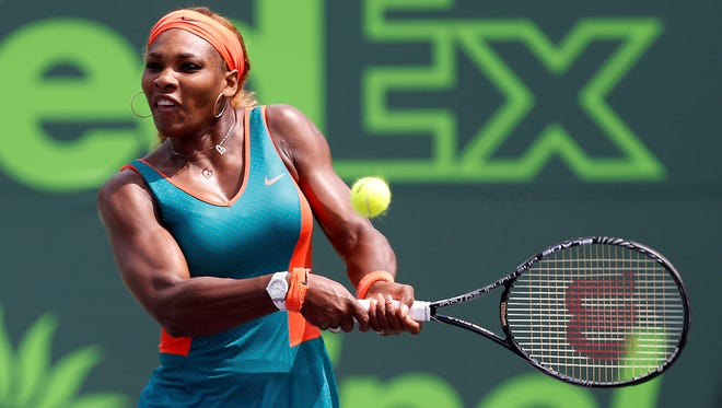 Serena Williams hits a backhand against Maria Sharapova (not pictured) on day eleven of the Sony Open at Crandon Tennis Center on Thursday.