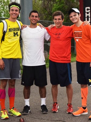 Northville's 4 x 400-meter relay team (from left) of Jason Ferrante, Adam Ghabra, Sean Flanagan and Jacob Kamm broke the conference and school records in 3:24.39.