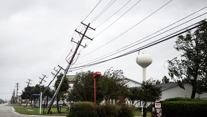 Oct 8, 2016; Myrtle Beach, SC, USA; A row of utility polls lean from the strong winds of Hurricane Matthew Hurricane Matthew. Mandatory Credit: Maddy Jones/Asheville Citizen-Times-USA TODAY Sports via USA TODAY NETWORK