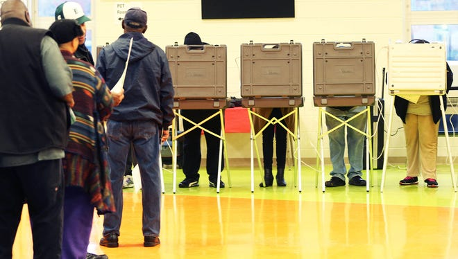 In Precinct 132 in Detroit's West Village at Marcus Garvey Academy, voters wait patiently in line to enter a booth to vote during the 2016 Presidential election on Tuesday, Nov. 8, 2016.