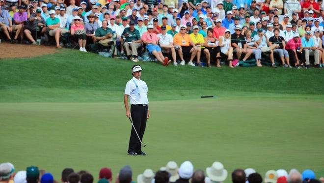 AUGUSTA, GA - APRIL 13:  Bubba Watson of the United States watches a putt on the 16th green during the final round of the 2014 Masters Tournament at Augusta National Golf Club on April 13, 2014 in Augusta, Georgia.  (Photo by David Cannon/Getty Images)