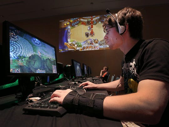 "Zachary Green plays ""League of Legends"" in the eBash Video Game room at Gen Con on Aug. 15, 2014."