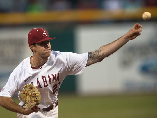 Alabama's Garret Rukes throws a pitch during the Capitol City Classic between Auburn and Alabama on Tuesday, March 28, 2017, in Montgomery, Ala.