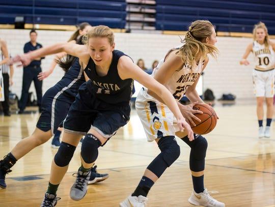 Dakota High School's Tara Bieniewicz (11) tries to
