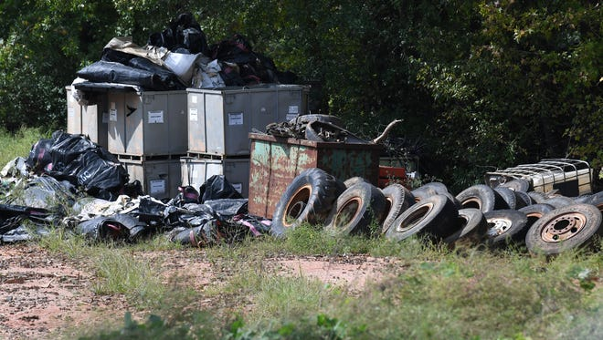 Used tires remain on the property of Viva Recycling in Homeland Park. The business is closed and its state permit was revoked last week.