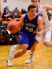Danbury's Justin Tibbels scored 13 points Thursday.